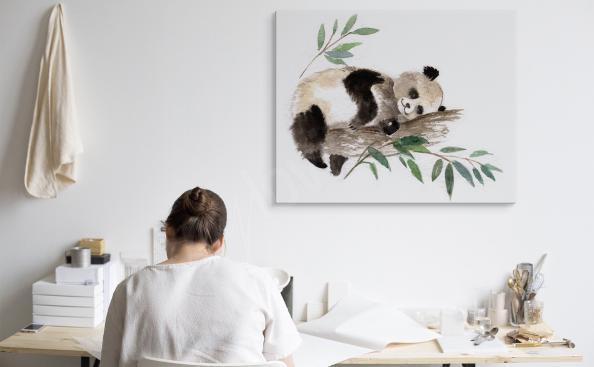 Image panda endormi dans un arbre