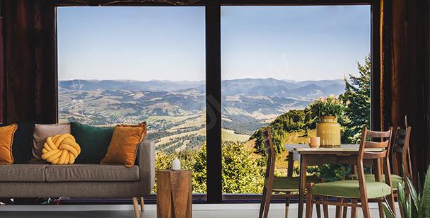Papier peint fenêtre vue sur les montagnes